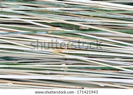 Bamboo is cut into thin strips.