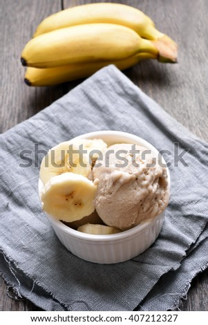 Banana ice cream in bowl, country style