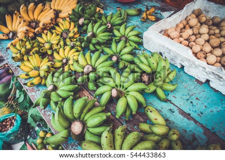 bananas on display at a market.