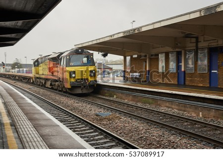 BANBURY, UK - DECEMBER 13, 2016: Train approaches the station under a typical British grey sky