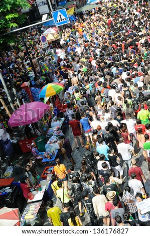 BANGKOK - APRIL 13: Unidentified people celebrate Songkran on April 13, 2013 in Silom in Bangkok. Silom is a very popular place in Bangkok for people who like to celebrate Songkran with water fights.