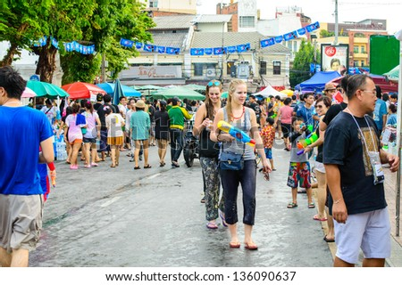 "BANGKOK - APRIL 13: Unidentified Thai and International people enjoy in ""Songkran Festival 2013 (Thailand new year)"" at Khao san Road on April 13, 2013 in Bangkok, Thailand."