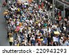 BANGKOK - AUG 18: Anti government protesters march on a city centre street on Aug 18, 2013 in Bangkok, Thailand. The protesters call for the government to be overthrown. - stock photo