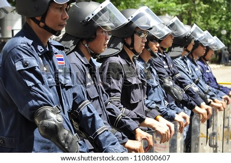 BANGKOK - AUGUST 22, 2012: Anti riot units are deployed at the Criminal Court. The Court decides to revoke bail for Red Shirt leader Yoswarit Chuklomon on August 22, 2012 in Bangkok.