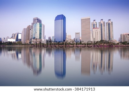 Bangkok cityscape, reflection of building still water, twilight time