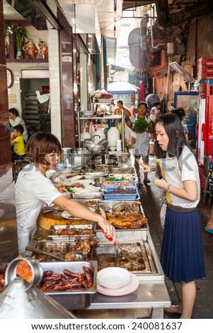 BANGKOK - DECEMBER 12: unidentified young women at a typical cook shop in Chinatown on December 12, 2014 in Bangkok. Bangkok is famous for its street food.
