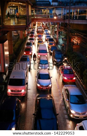 BANGKOK - JUNE 13: Traffic jam on the road after rain in rush our at Sukhumvit Rd. on June 13, 2013 in Bangkok, Thailand.In raining season, people can stuck 2 to 4 hours on the road in rush hour
