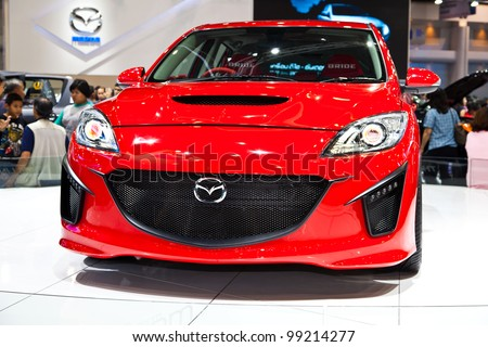 BANGKOK - MARCH 31: Mazda 3 on display in Challenger Hall, Impact Muangthong Thani,The 33 rd Bangkok International Motor Show in Bangkok,Thailand on March 31, 2012.