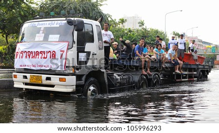 BANGKOK - NOV 4: A lorry navigates a flooded road in Pinklao district in rescuing flood victims as Thailand faces its worst flooding in 50 years on Nov 4, 2011 in Bangkok, Thailand.