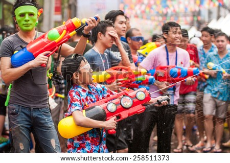 BANGKOK, THAILAND - APRIL 13, 2014: people playing water in Songkran festival on April 13, 2014 at Siam-Center in Bangkok