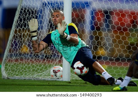 BANGKOK, THAILAND - AUGUST 06: Goalkeeper Victor Valdes of Barcelona FC in action during Barcelona FC training session at Rajamangala Stadium on August 06, 2013 in Bangkok, Thailand.