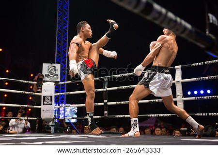 Bangkok, Thailand- December 21, 2014: Competition Finals to the Thai Boxer in World Muay Thai Fight 2014 at ASIATIQUE The Riverfront, Bangkok, Thailand on December 21, 2014.