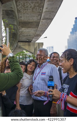 Bangkok, Thailand - FEB 7, 2014: PDRC - anti-government protesters and Mr. Suthep Thaugsuban, the PDRC Secretary-General during  the march in Silom area.
