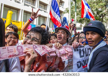 Bangkok, Thailand - FEB 7, 2014: PDRC - anti-government protesters in Silom area prepare money for donate to Mr. Suthep Thaugsuban, the PDRC Secretary-General.