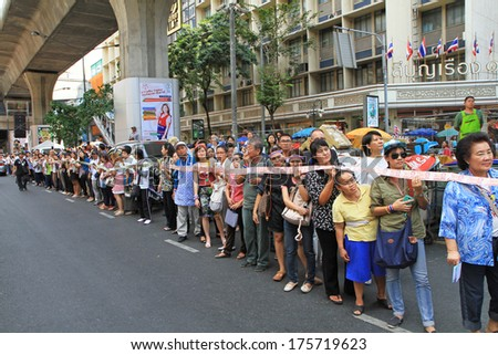 BANGKOK,THAILAND-FEBRUARY 7:Protesters hold cash donations for farmers before give to Suthep Thaugsuban led a procession of protesters in a march through Silom on February 7, 2014 in Bangkok,Thailand.