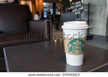BANGKOK, THAILAND - January 6, 2017: Starbucks hot beverage coffee with holder on the table of Starbucks fortune tower branch