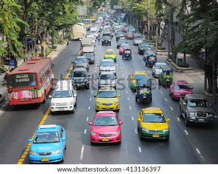 Bangkok, Thailand - January 20, 2011:Traffic moves slowly on a busy city centre road. Each year an estimated 150,000 cars join the heavily congested streets of the Thai capital.