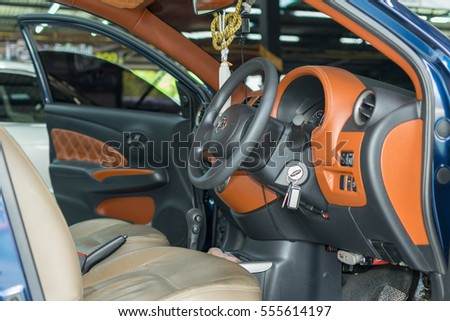 Bangkok, Thailand - January 16, 2016 : Unidentified car care staff cleaning the car (Car detailing).