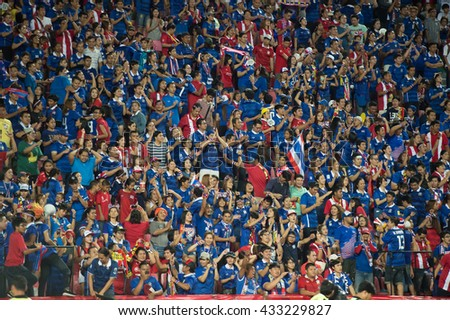 BANGKOK-THAILAND-5JUNE,2016:Unidentified fans of Thailand supporters celebrating  during match between match Kingâ??s cup between Thailand and Jordan at rajamangkala Stadium in Thailand on 5 june 2016