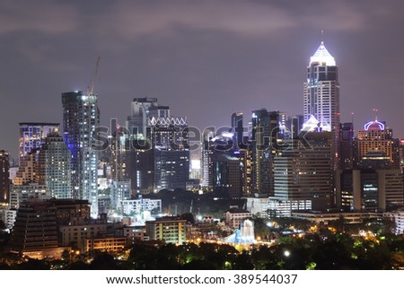 Bangkok Thailand - March 12, 2016 : Cityscape Modern building and Skyline of North Sukhumvit Bangkok over Lumpini park at night