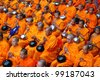 BANGKOK , THAILAND - MARCH 18: Monks waiting for people give food offerings on March 18, 2012 Pratunam in Bangkok, Thailand. Thai traditional Ceremony: BuddhaJayanti 2600 years - stock photo