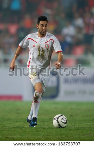 BANGKOK,THAILAND-MARCH: 05-Rabih Ataya #12 of Lebanon run with the ball during the AFC Asian Cup 2015 Group B Qualifier between Thailand and Lebanon at Rajamangala Stadium on March 5,2014 in,Thailand.