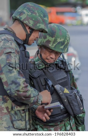 Bangkok ,Thailand - May 31 ,2014. Soldiers at victory Monument Were stationed around the area to keep the peace.