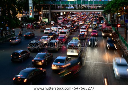 BANGKOK, THAILAND - MAY 14, 2016: View at the Ratchaprasong Intersection (near Central World) night traffic with light trails. This area is famous shopping area and traffic jam in Bangkok.