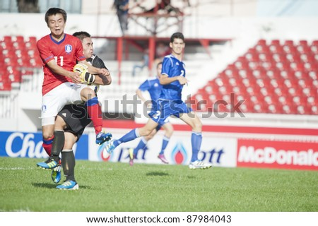 BANGKOK, THAILAND - NOV 2 : D.Donghyun (R) in action during AFC U-19 Championship 2012 between Korea Republic (R) and Guam (B) at Debhatsadin Stadium on November 2, 2011 in Bangkok, Thailand