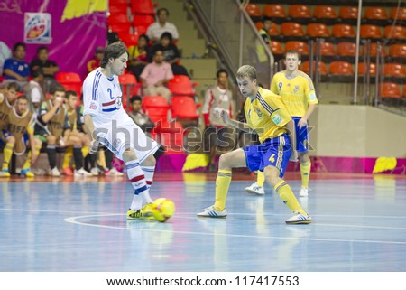 BANGKOK, THAILAND - NOV 1 : Unidentified players in FIFA Futsal World Cup Group A match between Ukraine and Paraguay at Indoor Stadium Huamark on November 1, 2012 in Bangkok, Thailand.