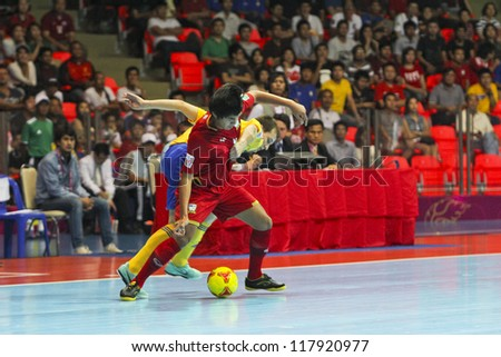 BANGKOK, THAILAND - NOV 04: Unidentified players in FIFA Futsal World Cup Group A match between Thailand (R) and Ukraine (Y) at Indoor Stadium Huamark on November 4, 2012 in Bangkok, Thailand.