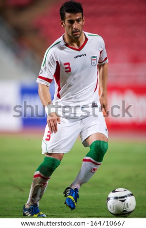BANGKOK THAILAND-NOVEMBER 15:Ehsan Hajsafi (white) of Iran control the ball during the 2015 AFC Asian Cup qualifiers between Thailand and Iran at Rajamangala stadium on Nov15, 2013 in Thailand.