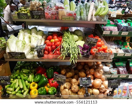 BANGKOK, THAILAND - NOVEMBER 30 : fresh organic vegetables and fruits for sale on stand or shelf in Tops Supermarket on November 30, 2016 in BANGKOK, Thailand.