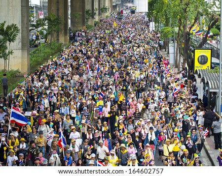BANGKOK, THAILAND - NOVEMBER 25: Protesters hold an anti-government rally on November 25, 2013 in Bangkok's main road. They blow whistles to make symbolic protest against the amnesty bill.