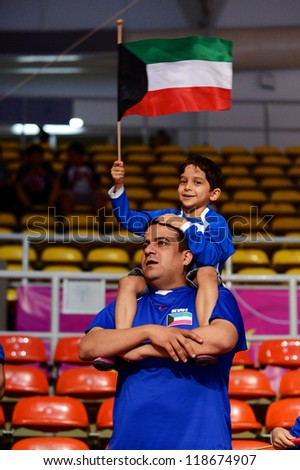 BANGKOK,THAILAND-NOVEMBER 06:Unidentified fans of Kuwait supporters during the FIFA Futsal World Cup between Kuwait and Serbia at Indoor Stadium Huamark on Nov6, 2012 in Bangkok,Thailand.