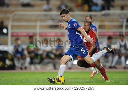 BANGKOK THAILAND-NOVENBER 24:Juan Luis Aldeguer Guirado (blue) of Philippines in action during the AFF Suzuki Cup between Thailand and Philippines at Rajamangala stadium on Nov24,2012 in,Thailand.
