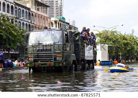 BANGKOK, THAILAND - OCT 30 : Rescue teams helping people to get home during the worst flooding in decades on Oct 30,2011  Bangkok, Thailand.
