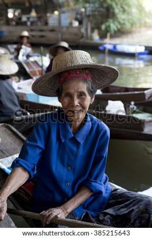 BANGKOK - THAILAND / 02.12.2015: Portrait of the elderly thai woman at the Damnoen Saduak Floating Market in Bangkok