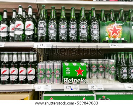 BANGKOK, THALAND - DECEMBER 10, 2016: Heineken beer cans and bottles on the shelf at Tesco Lotus supermarket.