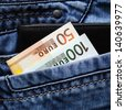 banknotes, euro banknotes in the pocket of his trousers - stock photo