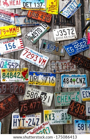 BAR HARBOR, MAINE - JULY 8: Old car license plates on the outside wall in Bar Harbor on July 8, 2013.