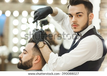 Barber Gloves : Barber with dark hair wearing white shirt, watch and black gloves ...