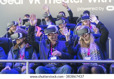 BARCELONA - FEBRUARY 24: people trying the new Samsung Gear VR a glasses mobile virtual reality device on the stand of the Mobile World Congress 2016 on February 24, 2016, Barcelona, Spain.