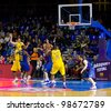 BARCELONA - FEBRUARY 29: Some players in action during the Euroleague basketball match between FC Barcelona and Maccabi, final score 70-67, on February 29, 2012, in Palau Blaugrana, Barcelona, Spain. - stock photo