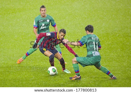 BARCELONA - JANUARY 29: Alexis Sanchez (middle) in action at Copa del Rey - Spanish Cup - match between FC Barcelona and Levante, 5-1, under an intense rain, on January 29, 2014, in Barcelona, Spain.