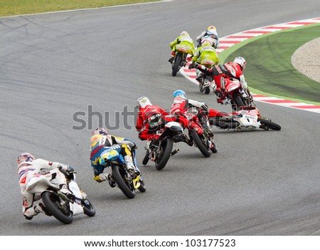BARCELONA - JUNE 5: Some unidentified riders have an accident at Moto 125 Grand Prix of Catalunya, on June 5, 2011 in Barcelona, Spain.