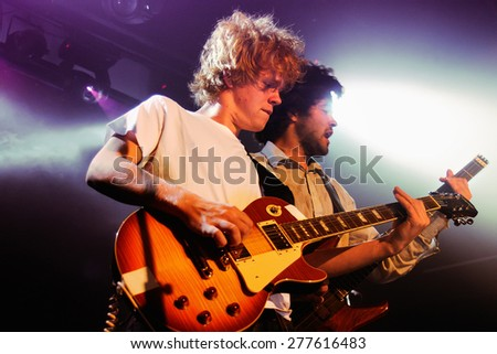 BARCELONA - OCT 27: Guitarist of Kakkmaddafakka (Norwegian indie rock band) performs at Music City Hall on October 27, 2011 in Barcelona, Spain.