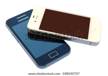 BARCELONA, SPAIN - APR 08, 2014: Photo of a white Apple Iphone device above a black Android Samsung Galaxy device, isolated in white background.