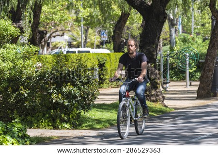 Barcelona, Spain - April 14, 2015: Cyclist circulating for a bike path in central Barcelona