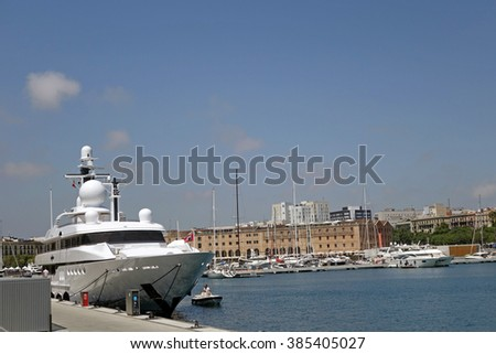 BARCELONA, SPAIN - AUGUST 6, 2015: Yachts and boats parked during a hot summer noon at port of Barcelona, Spain